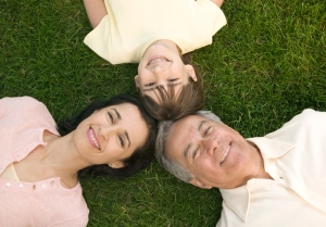 Family Lying Down on the Grass